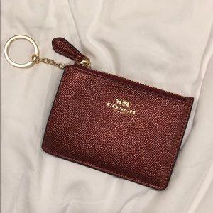 Metallic burgundy coach coin purse